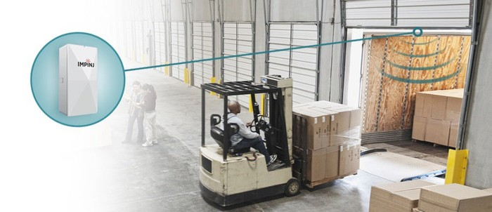 A forklift moving boxes on a pallet