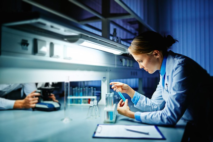 Lab researcher examining test tubes