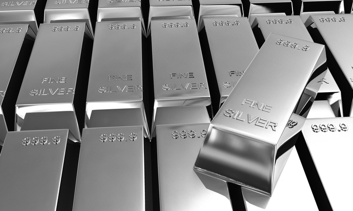 Stacked silver bars.
