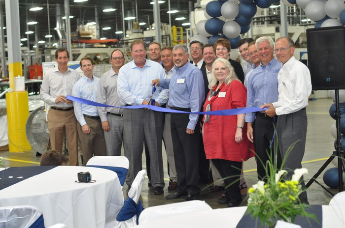 Employees celebrating a plant opening.
