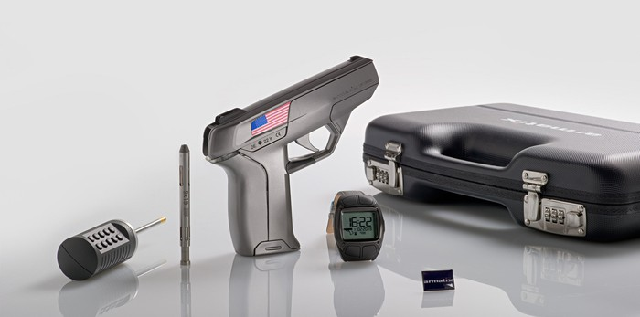 The Armatix iP1 system with smart gun, activating wrist band, locking mechanisms, and carrying case