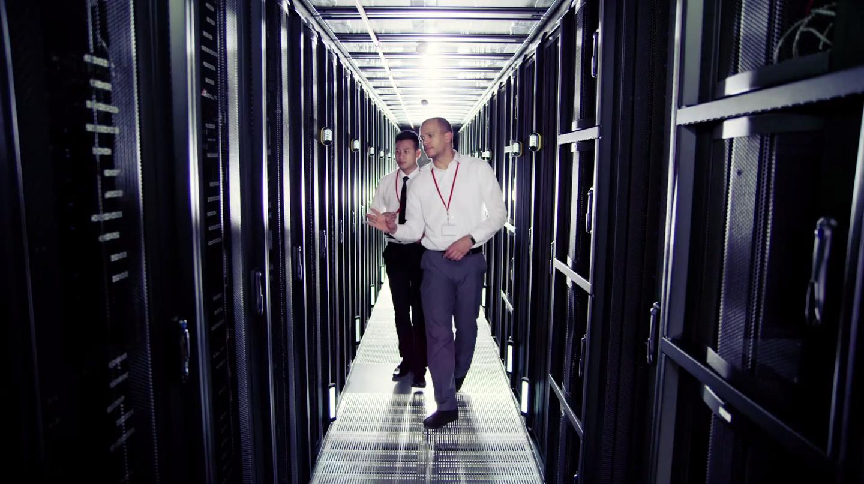 Two men walking in Nutanix' data center