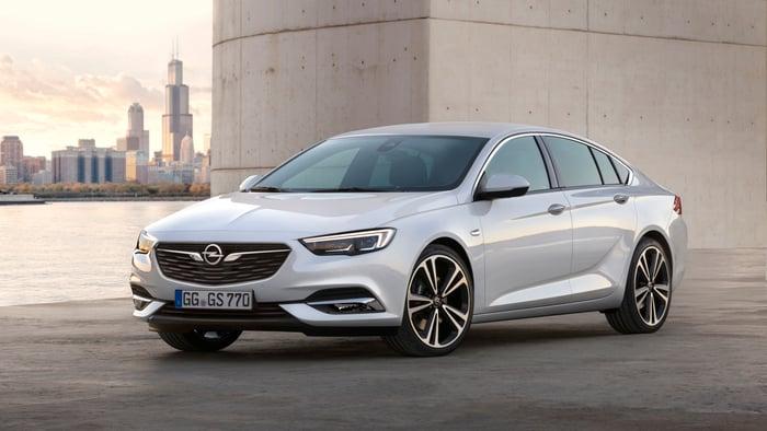 A white Opel Insignia Grand Sport sedan.