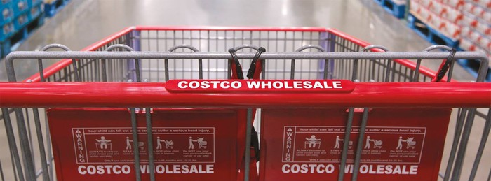 A Costco shopping cart moving down the aisle.