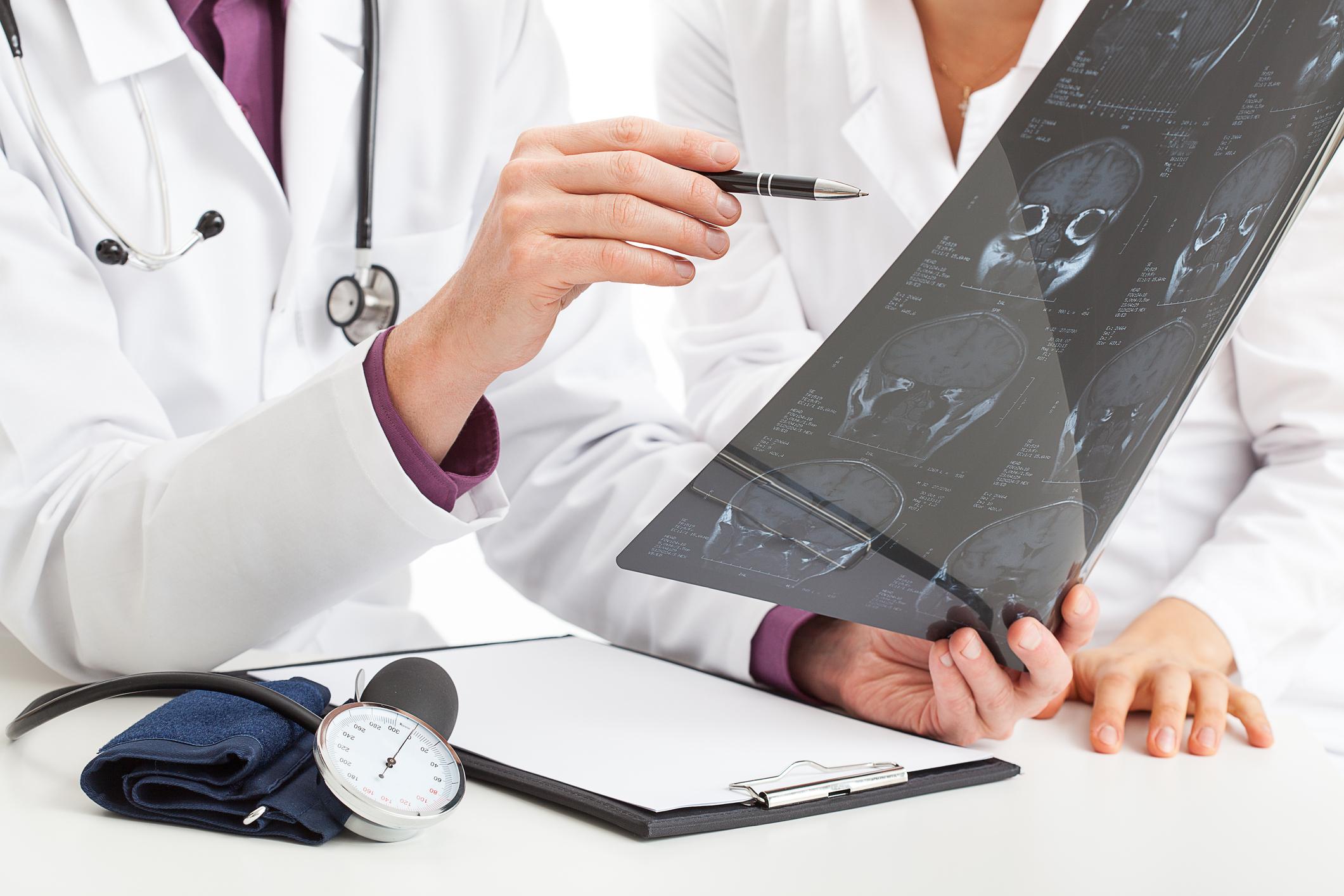 Doctors examining an x-ray.