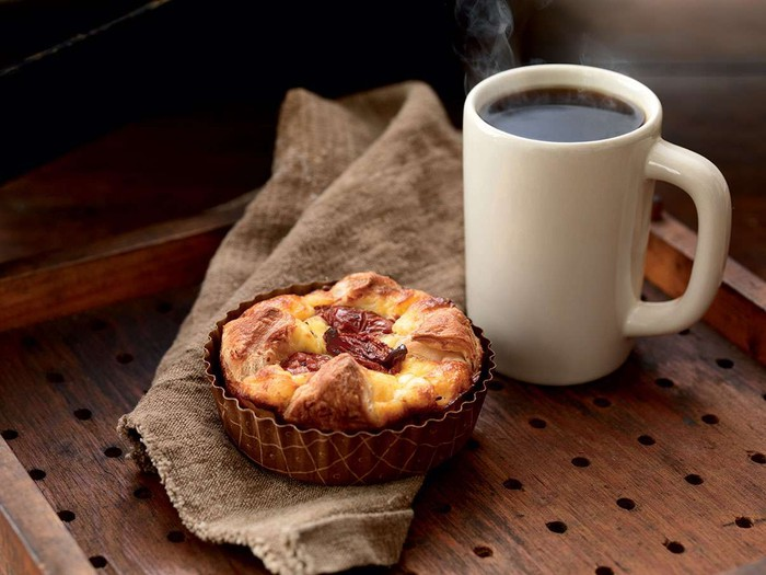A pastry and coffee on a table.