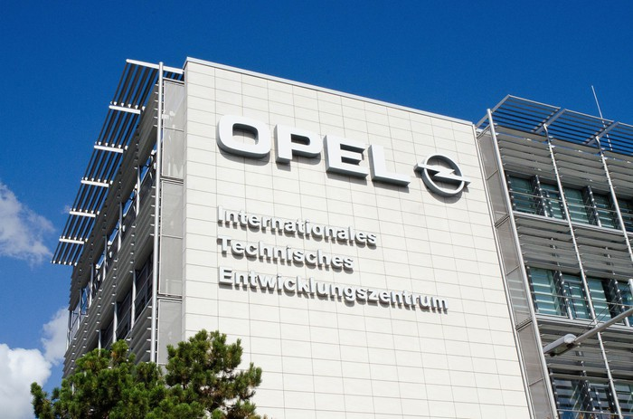 A close-up of the sign on the headquarters building at Opel's engineering center.