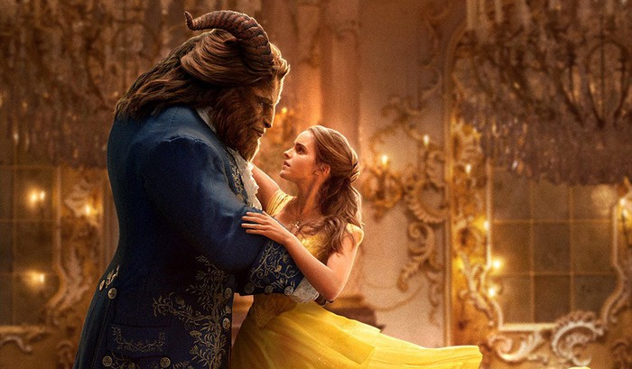 A scene from the upcoming live action remake of Beauty and the Beast with Belle and the Beast dancing in a ballroom.