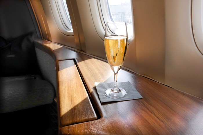 First class airplane seat with champagne.