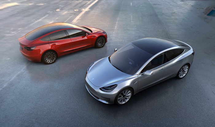 Picture of two Model 3 sedans.