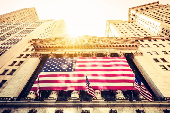 The sun shining above the New York Stock Exchange.