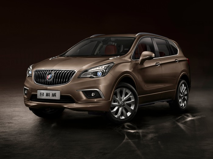 A Chinese-market version of the midsize Buick Envision SUV, in tan against a dark background.