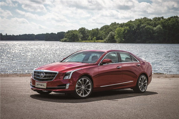 A red Cadillac ATS-L sedan next to a lake.