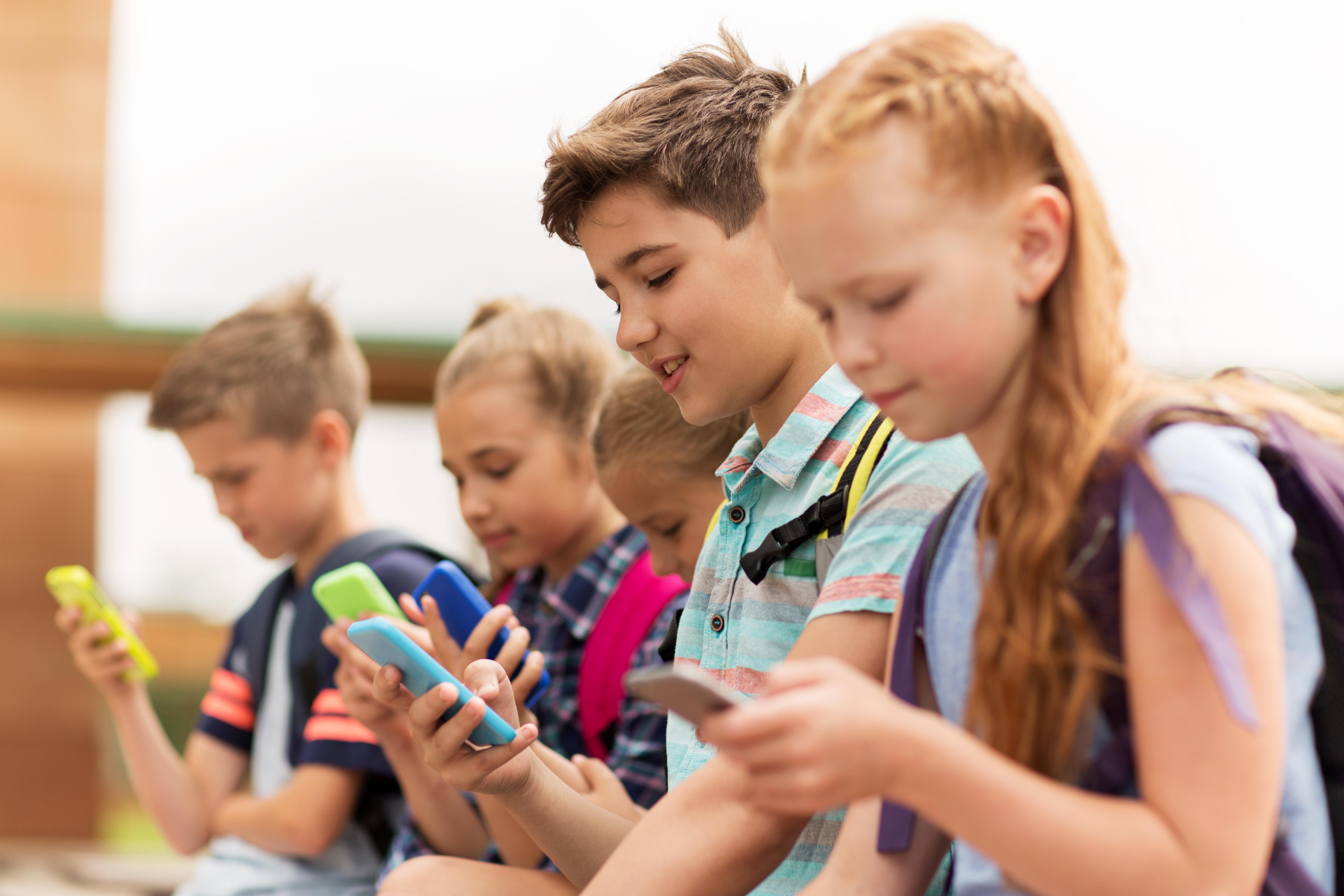 Children using smartphones.