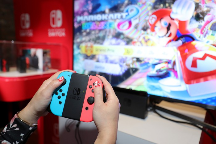 An individual using the Nintendo Switch console.