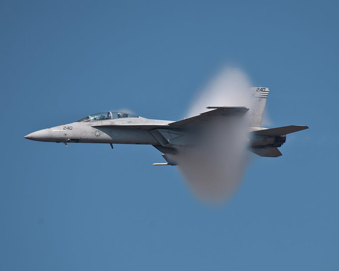 Boeing F/A-18 fighter breaking the sound barrier.