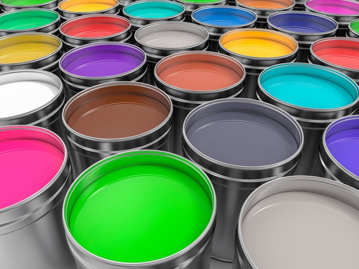 Rows of different colored paint cans.