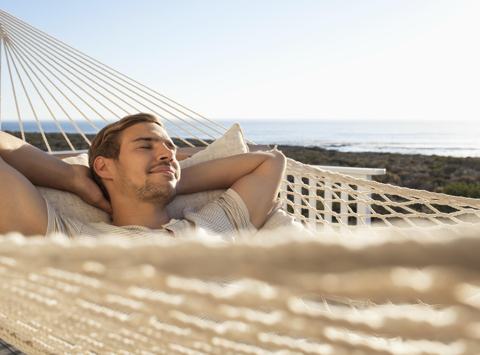 Man sleeping in hammock.
