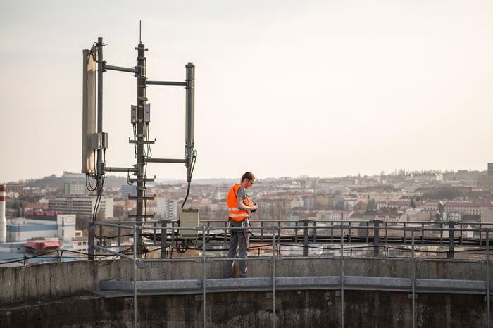 A telecom worker examining a base station
