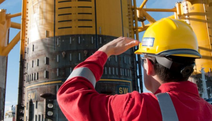 A Royal Dutch Shell employee looking up.