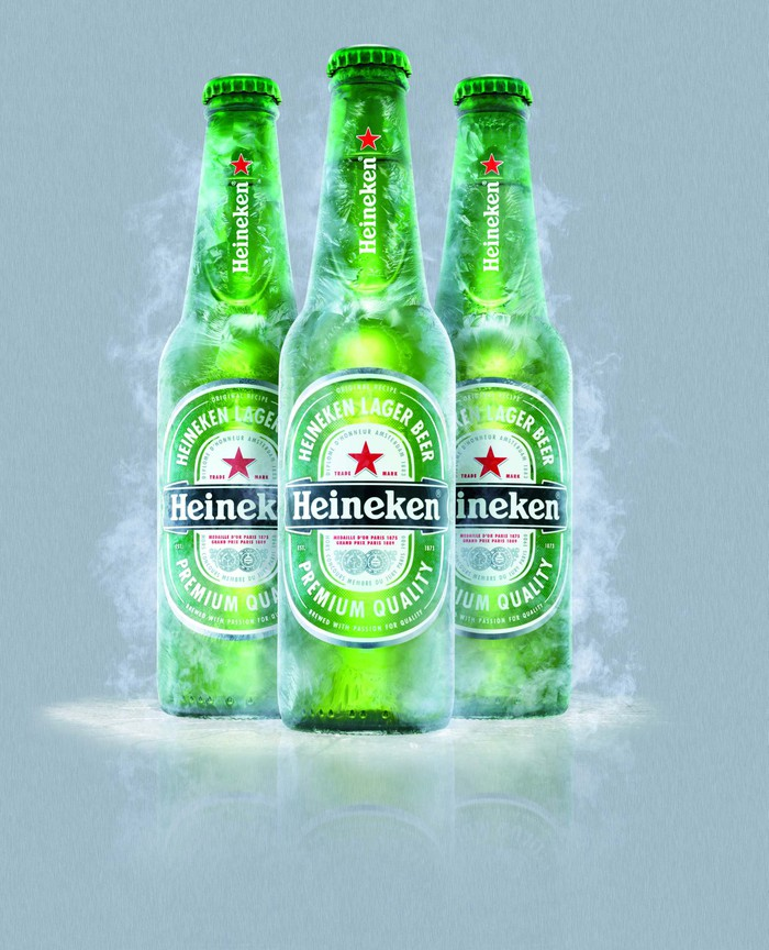 Three distinctive green Heineken beer bottles
