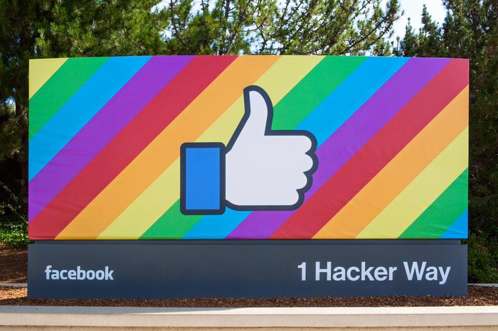 "Image of the entrance to Facebook's corporate campus at 1 Hacker Way, featuring the thumbs-up from its ""Like"" feature."