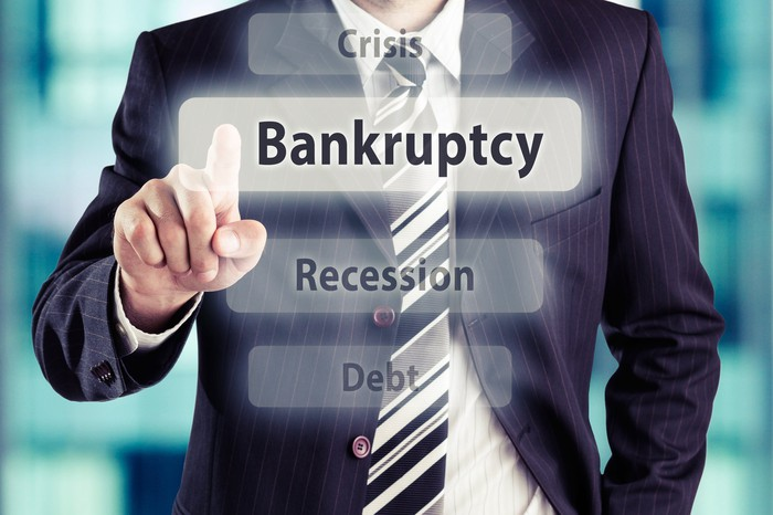 Businessman pointing toward bankruptcy.