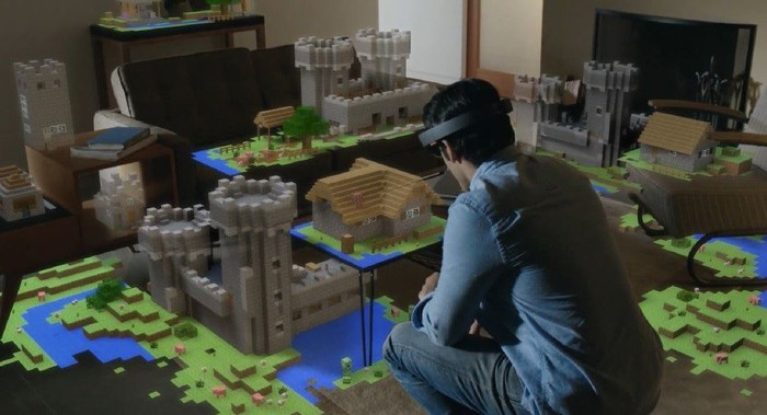A man uses Microsoft's HoloLens to play Minecraft.
