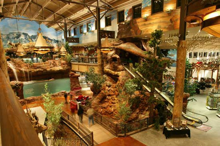 There's a theme park or museum-like quality to the interior of a Bass Pro Shops store
