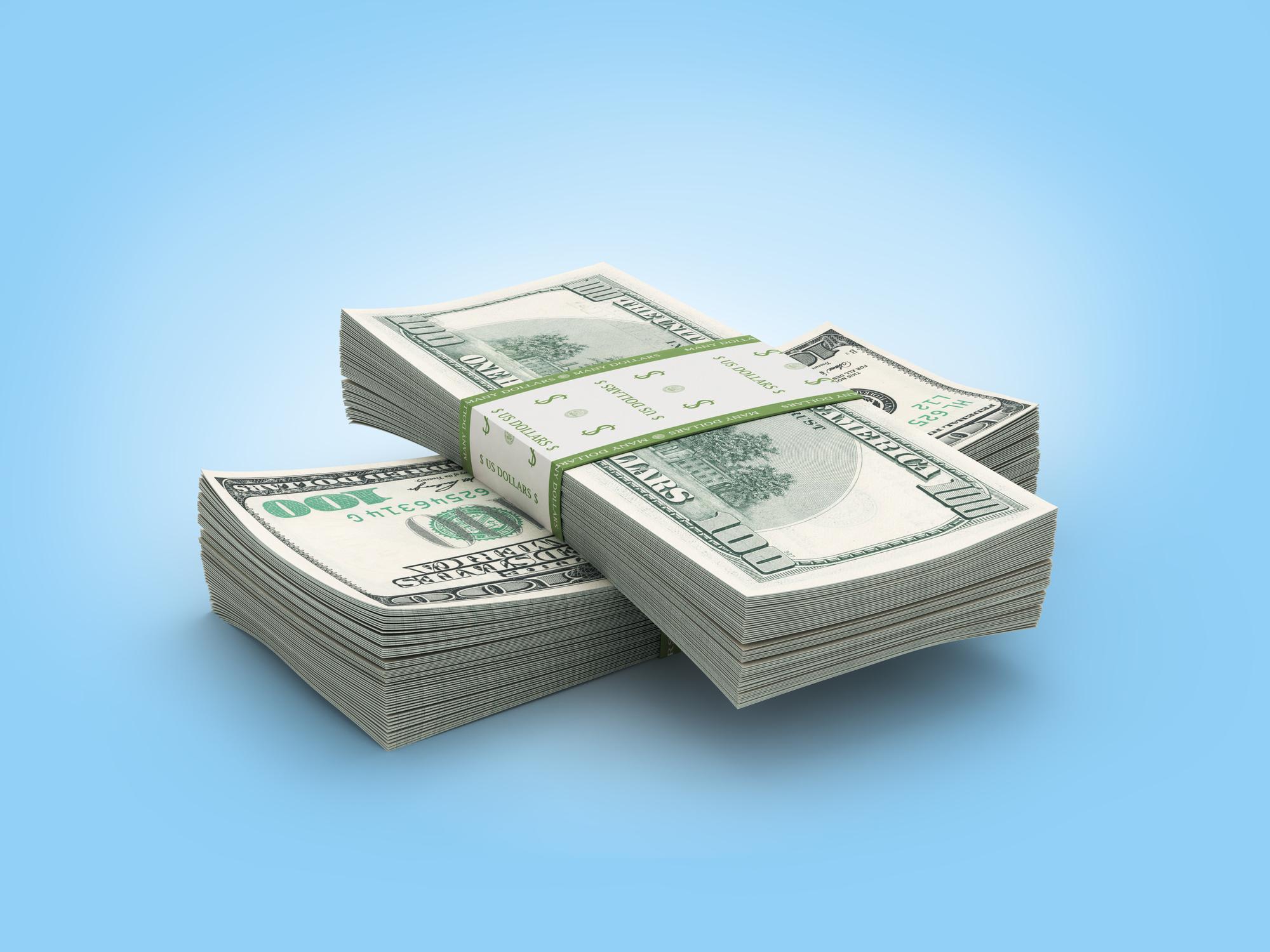 Two criss-crossed stacks of hundred-dollar bills.