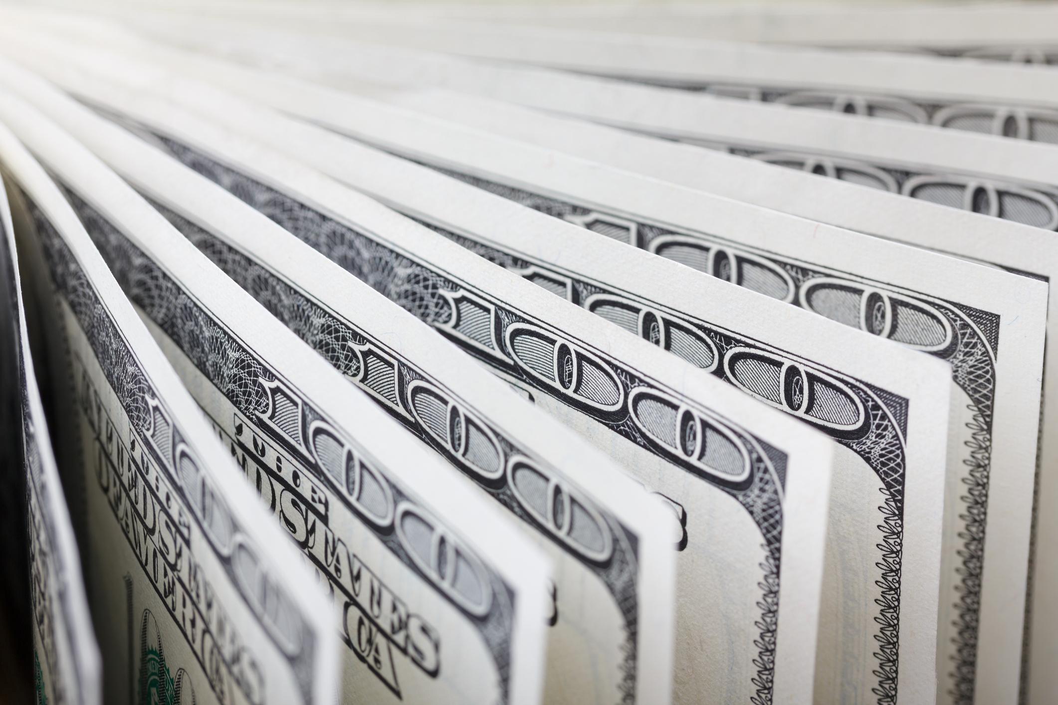 Hundred dollar bills in a row