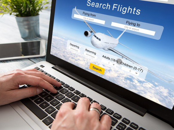 Online Travel Industry Booking Site on Laptop Screen