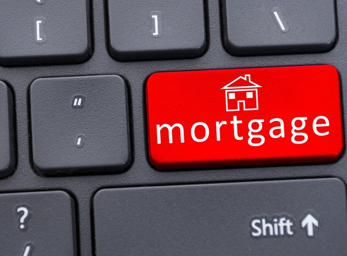 Button of mortgage text on red keyboard in closeup
