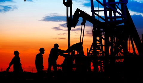 oil rig at sunset with workers