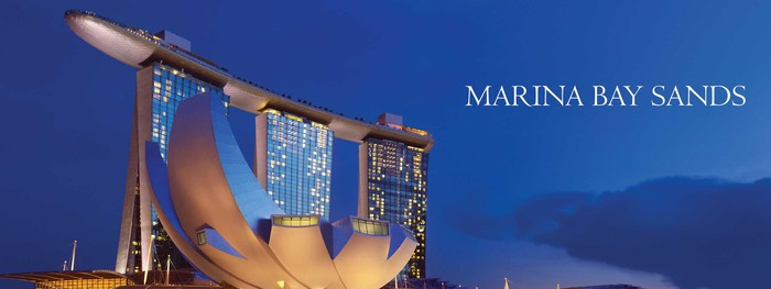 The Marina Bay Sands resort shaped like a boat atop three hotel towers sets right on the bay in Singapore.