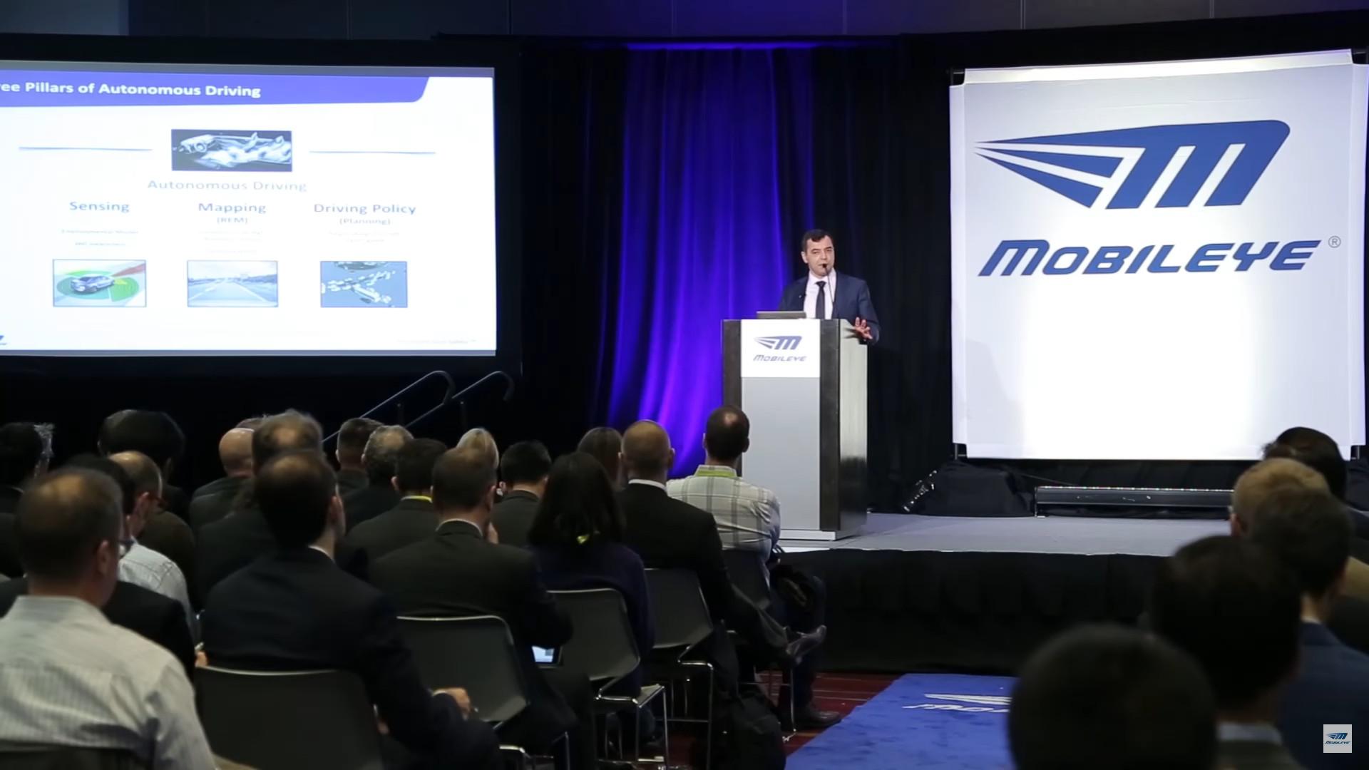 Mobileye executive giving a presentation at a conference.