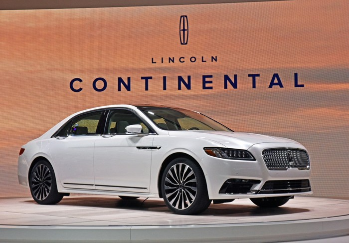 A white Lincoln Continental on display.