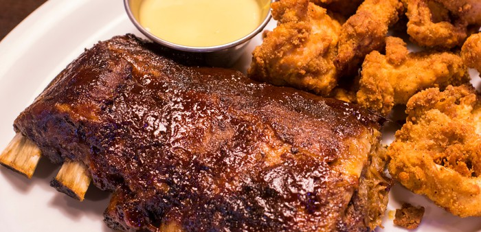 "The ""ultimate"" catering feast featuring ribs, chicken tenders, and sides at Ruby Tuesday."
