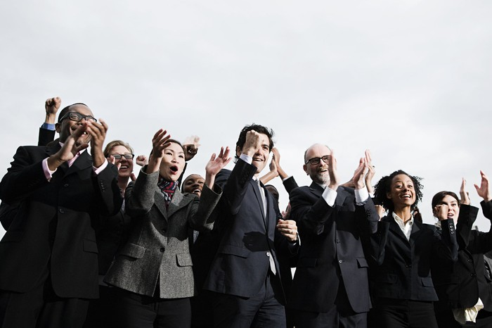 Business people clapping and cheering