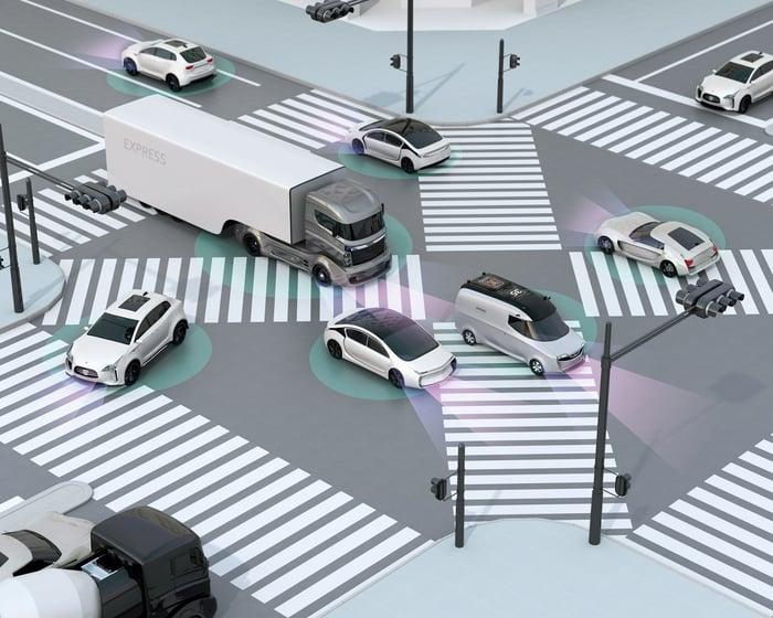 Rendering of autonomous vehicles on a public street.