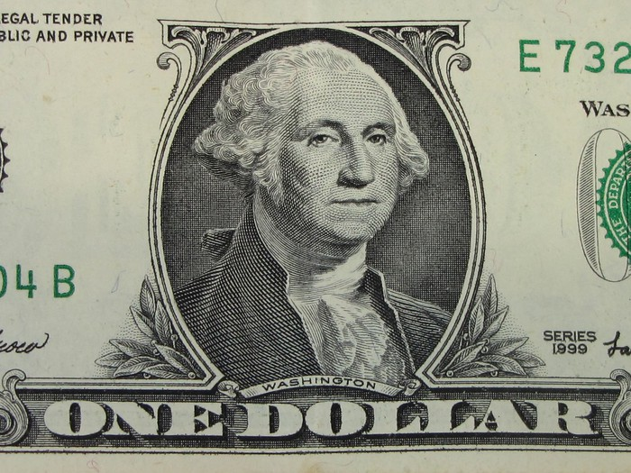 A close-up of a one dollar bill.