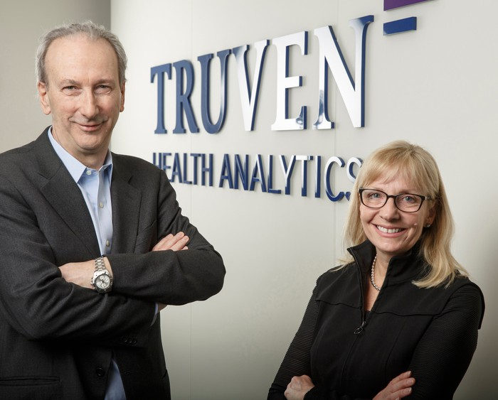 Truven Health Analytics CEO Mike Boswood, left, and IBM Watson Health General Manager Deborah DiSanzo, right.