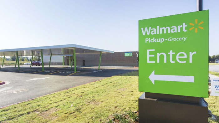 A sign guiding shoppers to Wal-Mart's grocery pickup station