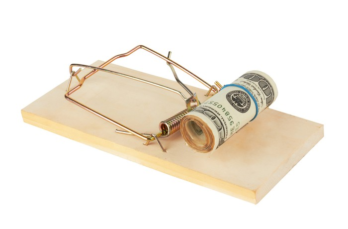Roll of cash on a mouse trap.