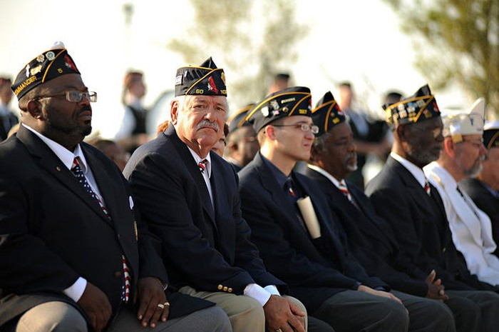 Veterans sitting in attendance for a 9/11 remembrance parade.