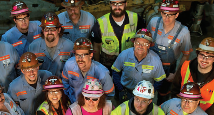 Barrick Gold employees looking up.