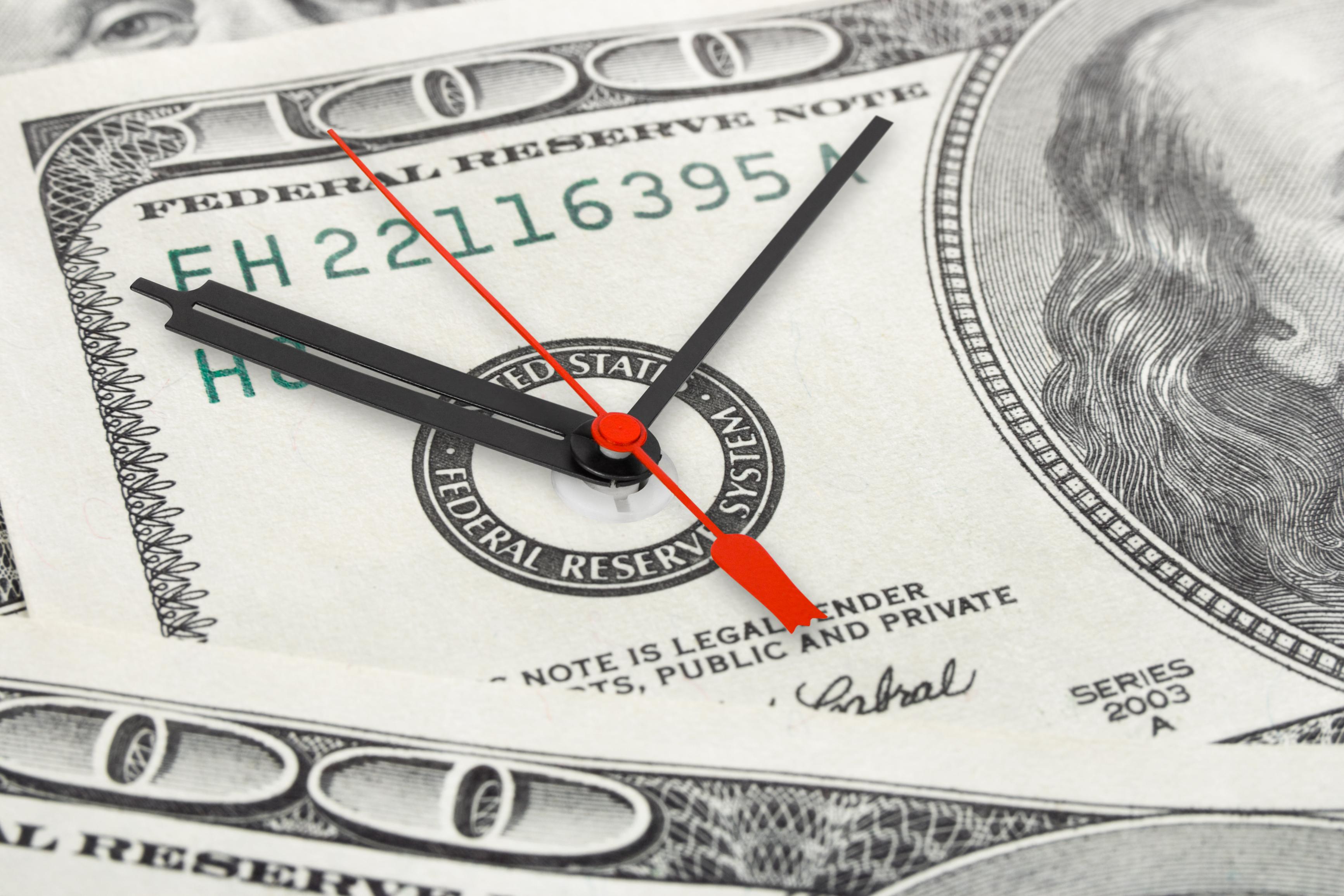 Clock hands built into a $100 bill