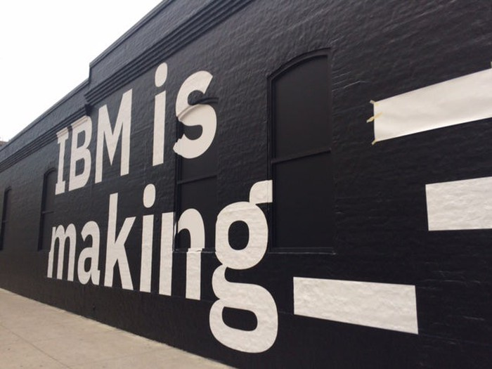"Mural of ""IBM is making"" printed on a wall."