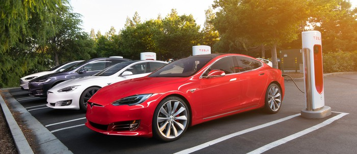Tesla vehicles at a Supercharger