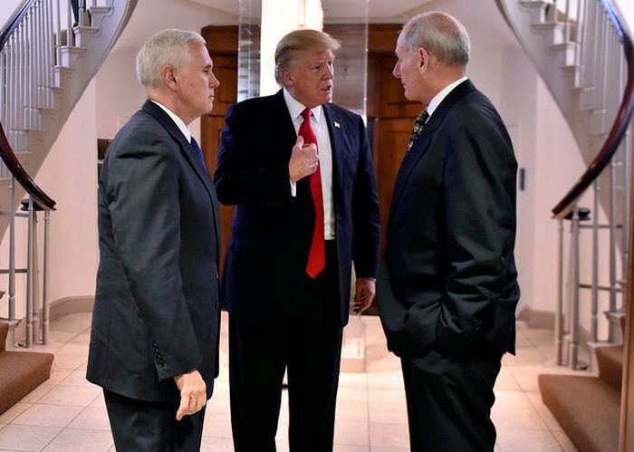 Donald Trump flanked by VP Mike Pence and Secretary of the Department of Homeland Security, John Kelly.